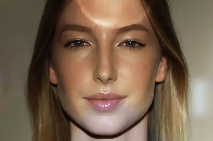 Front view of a woman's face with light reflecting on her